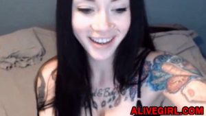 Adorable young inked brunette PaigeBlue fucks a sweet pussy