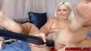 Blonde MidwestMILF enjoys double penetrated with baseball bat