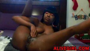Bootylicious ebony Caramel masturbates and squirts black pussy